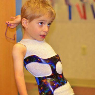 Лечение искривления позвоночника у детей: массаж спины при сколиозе, видео